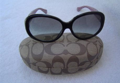 I found these great Coach semi-cat's eye sunnies on eBay, and I can get them before I leave for the trip!